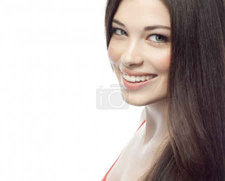 Photo for Closeup portrait of attractive  caucasian smiling woman brunette isolated on white studio shot lips toothy smile face hair head and shoulders - Royalty Free Image