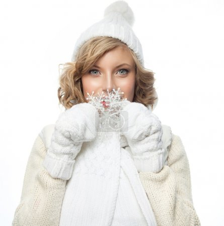 Photo for Portrait of attractive young caucasian woman   face skin care in warm clothing  studio  shot isolated on white  winter snowflake - Royalty Free Image
