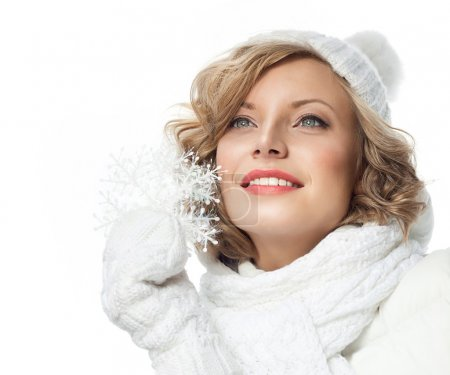 Photo for Portrait of attractive young caucasian woman  toothy smile  face skin care in warm clothing  studio  shot isolated on white smiling winter snowflake - Royalty Free Image