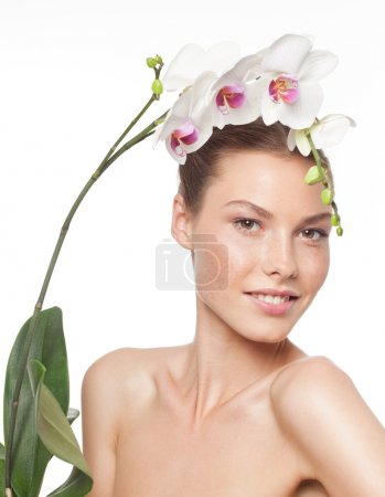 Photo for Closeup portrait of attractive  caucasian smiling woman brunette isolated on white studio shot lips toothy smile face hair head and shoulders looking at camera tooth flower - Royalty Free Image