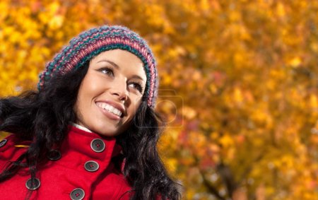 young woman outdoors with autumn leaves