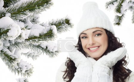 woman winter portrait  chistmas tree covered with snow