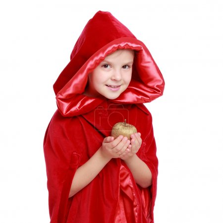 Beautiful child in a bright red cloak on Holiday
