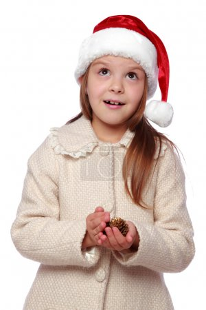 Lovely child in a Santa hat is happy and laughs