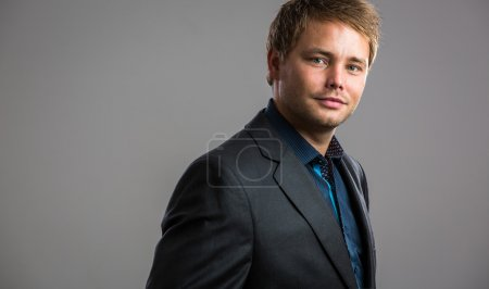 Photo for Handsome, young businessman - well dressed, against grey background - Royalty Free Image