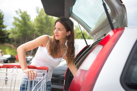 Woman shopping in a grocery store or supermarket