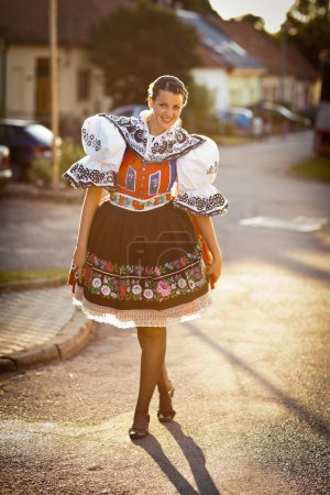 Photo for Keeping tradition alive: young woman in a richly decorated ceremonial folk dress, regional costume (Kyjov folk costume, Southern Moravia, Czech Republic) - Royalty Free Image