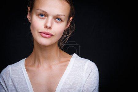 Very pretty young woman's simple studio portrait