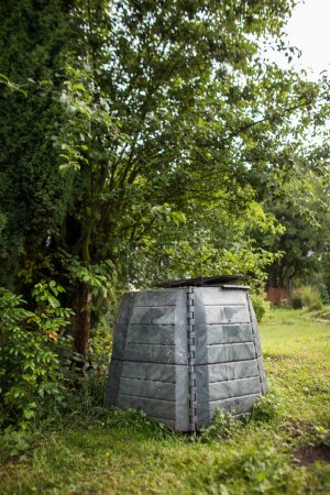 Plastic composter in a garden