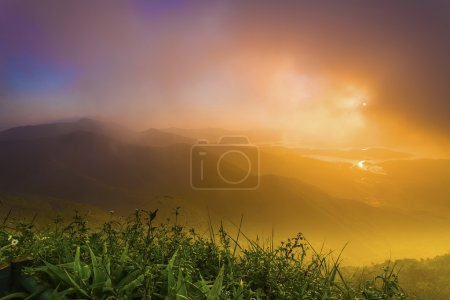 Sunrise at mountains in summer
