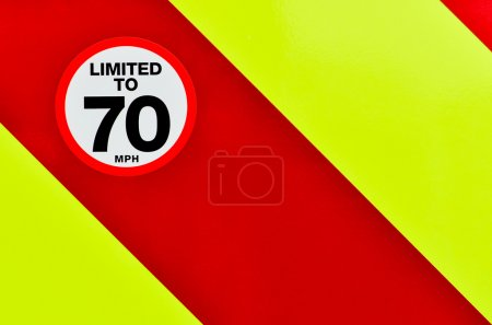 Speed limited sign on the back of a vehicle with high visibility chevrons