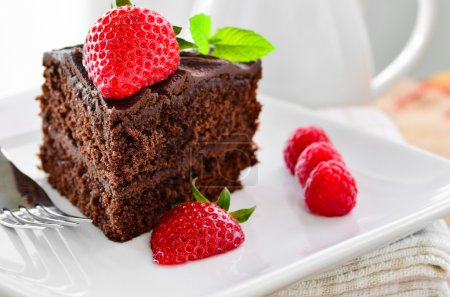 Photo for Fresh home made sticky chocolate fudge cake and a jug of fresh pouring cream. - Royalty Free Image