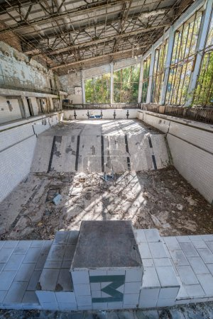 Photo for Lazurny (eng. Azure) swimming pool in Pripyat ghost town, Chernobyl Nuclear Power Plant Zone of Alienation, Ukraine - Royalty Free Image