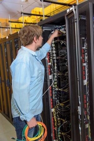 IT specialist working in datacenter