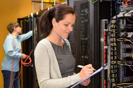 Woman IT engineer in server room
