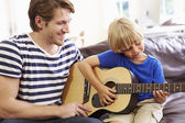 Father with Son  Play Guitar