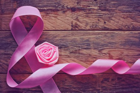 Photo for Background with a pink silk ribbon, International Women's Day - Royalty Free Image