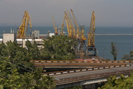 Ship-repair yard. Industrial zone of sea cargo port with grain dryers, containers, cranes and storehouses photo