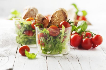 Healthy salad with tomatoes and bread