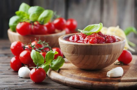 Photo for Italian homemade traditional sauce with tomatoes and basil, selective focus - Royalty Free Image