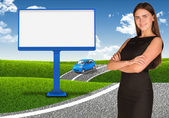 Businesswoman with small car and empty billboard