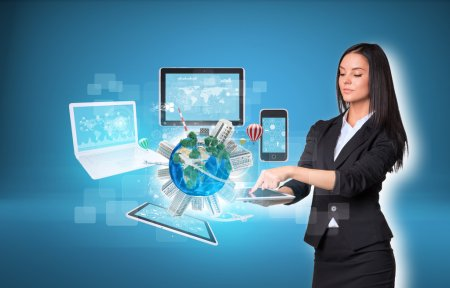 Woman using digital tablet and Earth with electronics
