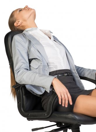 Businesswoman resting in office chair with her hea...