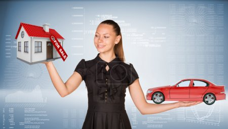 Businesslady holding car and house