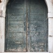 Wooden arched door in house with doorsteps, front ...