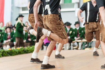 Photo for Young men doing an austrian traditional folk dance - Royalty Free Image
