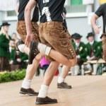 Young men doing an austrian traditional folk dance...