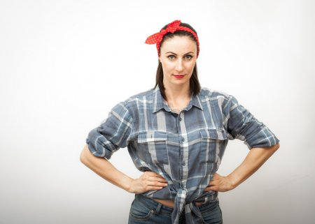 Woman in flanel shirt and red hair bow
