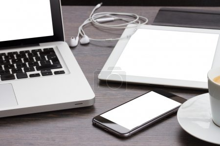 Photo for Modern computer devices  - laptop, tablet and phone with copy space on screen - Royalty Free Image