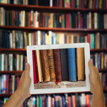 tablet with library shelfs in background