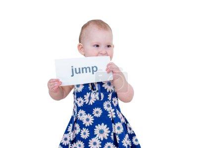 Little girl holding a card