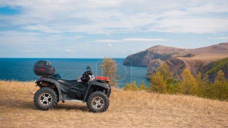 ATV on a rocky seashore