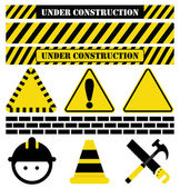 Collection of Construction imagery including UNDER CONSTRUCTION text as well as common tools and symbols used in relation to construction