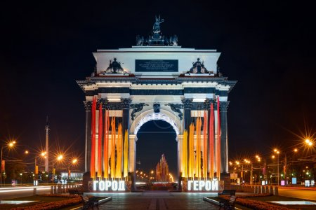 "View to Triumphal Arch on Kutuzovsky prospect Moscow with luminous inscription ""HERO-TOWN"" in the night"
