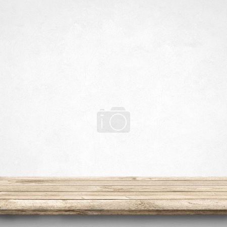 Wood table and white concrete wall
