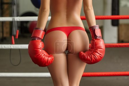 Image of female boxers elastic ass in thong