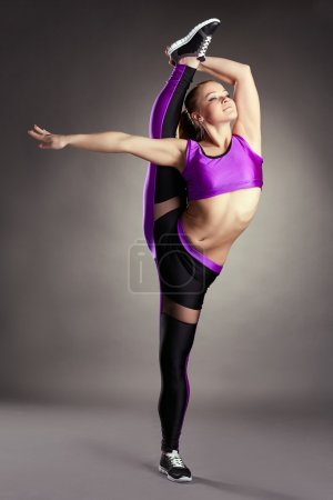 Flexible girl posing in vertical splits