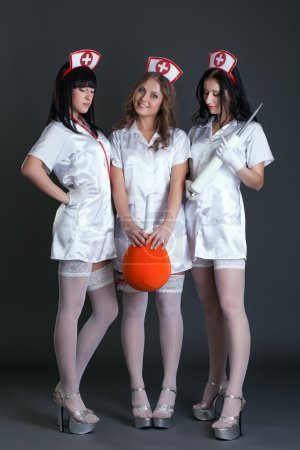 Studio photo of girls dressed as sexy nurses