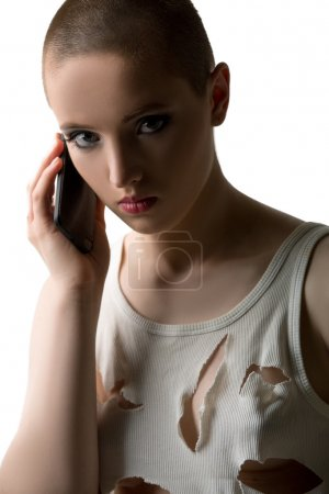 Photo for Studio portrait of skinhead girl talking on phone - Royalty Free Image