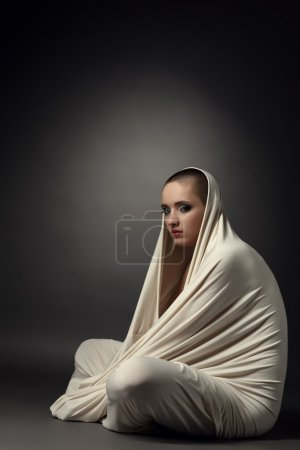 Photo for Image of girl posing as insane patient in straitjacket - Royalty Free Image