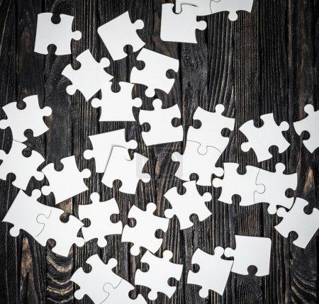 white puzzle pieces on dark background