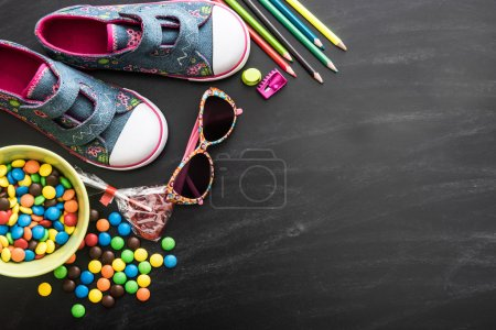 Photo for Kids stuff and sweets on a white background - Royalty Free Image