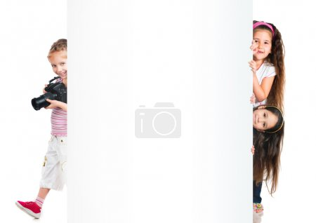 Photo for Funny little kids with big white banner - Royalty Free Image