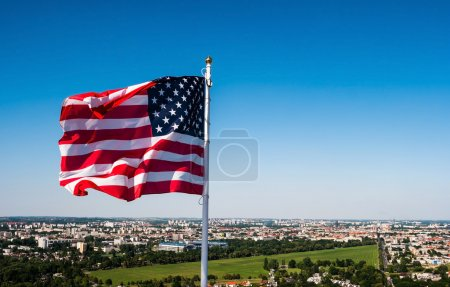 american flag waving in the sky
