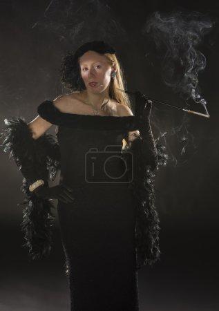 Glamorous 1940s Film Noir Woman Smoking Cigarette