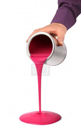Photo for Hand pouring red pink paint from tin can isolated on white - Royalty Free Image